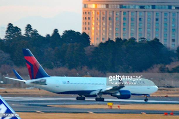 Delta Air Lines 588 bound for Seattle from Shanghai is seen after making an emergency landing at Narita International Airport on December 14 2017 in...