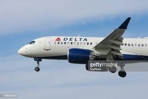 Delta Air Lines Airbus A220-100 aircraft as seen on final approach landing with landing gear down at New York JFK John F. Kennedy International...