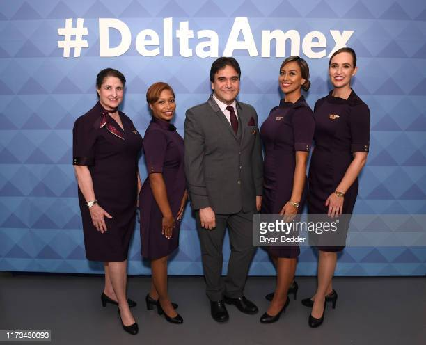 Delta Air Lines crew members pose during the American Express and Delta Air Lines #DeltaAmex Card Relaunch event at 14th Street Garage on October 02,...