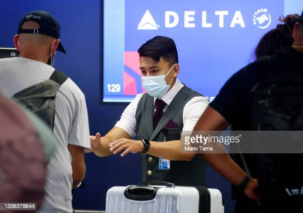 Delta Air Lines employee works on the departures level at Los Angeles International Airport on August 25, 2021 in Los Angeles, California. Delta is...
