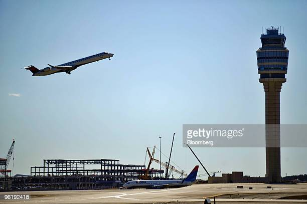 A Delta Air Lines Inc jet takes off at HartsfieldJackson International Airport in Atlanta Georgia US on Tuesday Jan 26 2010 Delta Air Lines Inc the...
