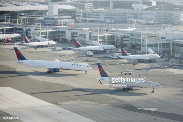 Delta Air Lines Inc planes stand at John F Kennedy International Airport in New York US on Thursday July 5 2018 Delta Air Lines Inc is scheduled to...