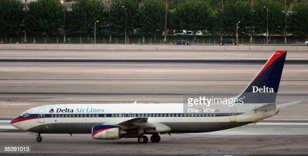 Delta Air Lines jet taxis at McCarran International Airport September 12 2005 in Las Vegas Nevada Delta's stock plunged more than 22% to an alltime...