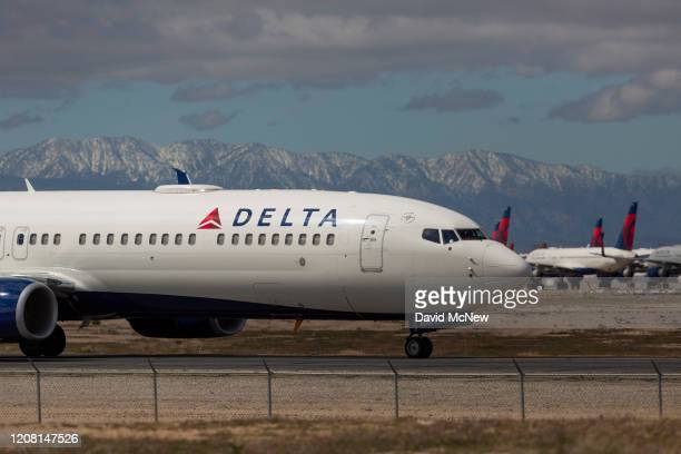 Delta Air Lines jet taxis to be parked with a growing number of jets at Southern California Logistics Airport on March 24, 2020 in Victorville,...
