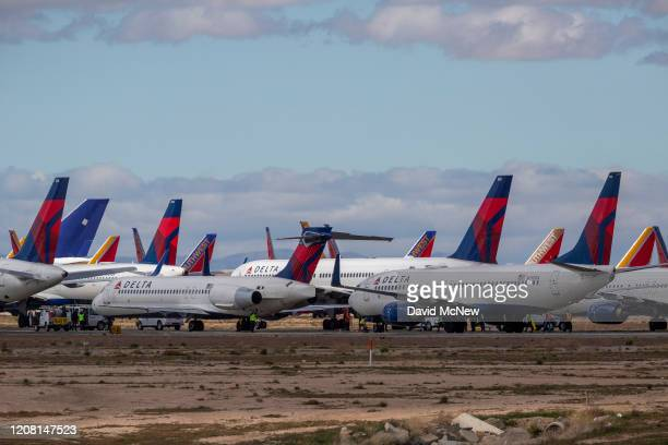 Delta Air Lines jets are parked in growing numbers at Southern California Logistics Airport on March 24 2020 in Victorville California As the...