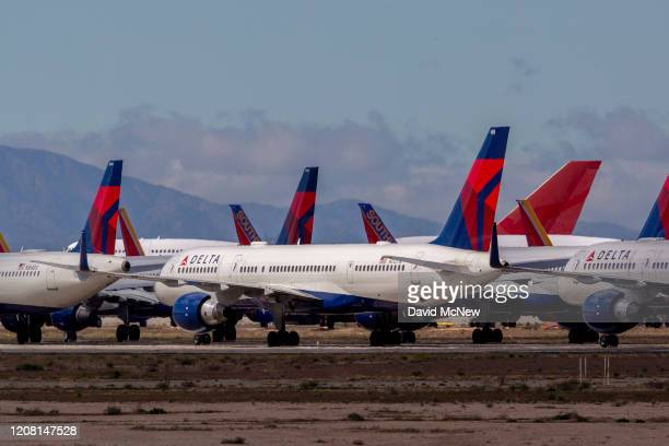Delta Air Lines jets are parked in growing numbers at Southern California Logistics Airport on March 24, 2020 in Victorville, California. As the...