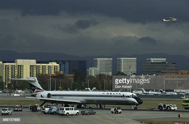 A Delta Air Lines MD–80 jetliner inbound from Dallas reportly made an emergency landing at John Wayne Airport at 1222 pm Friday with three of it's...