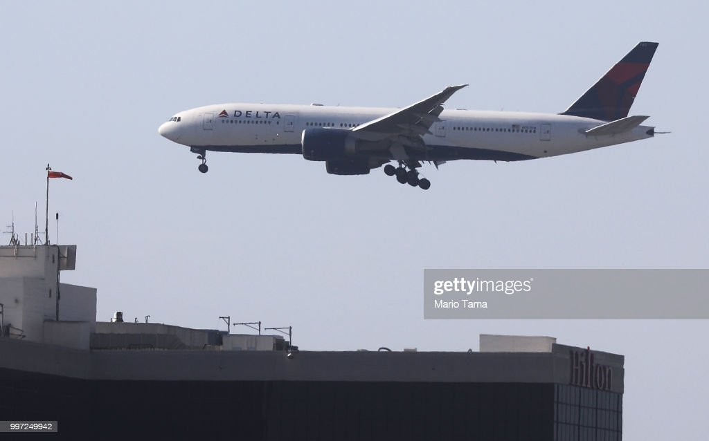 A Delta Air Lines plane lands at Los Angeles International Airport on July 12, 2018 in Los Angeles, California. Delta announced today that it will increase fares by reducing the supply of seats in an effort to offset higher fuel prices.