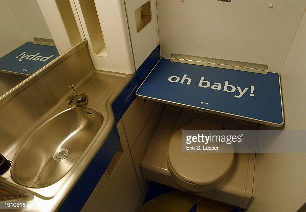 Delta Air Lines unveils its new lowfare airline Song's Boeing 757 interior including a lavatory with a baby changing table April 10 2003 at...