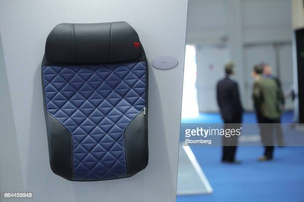 Delta' airline seat cover sits on display at the Sabeti Wain Aerospace pavilion at the 2017 Aircraft Interiors Expo in Hamburg, Germany, on Tuesday,...