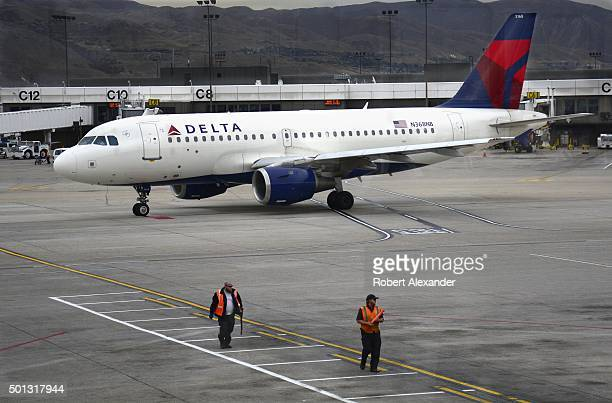 Delta Airlines Airbus A319 passenger aircraft taxis toward the runway at Salt Lake City International Airport in Salt Lake City Utah
