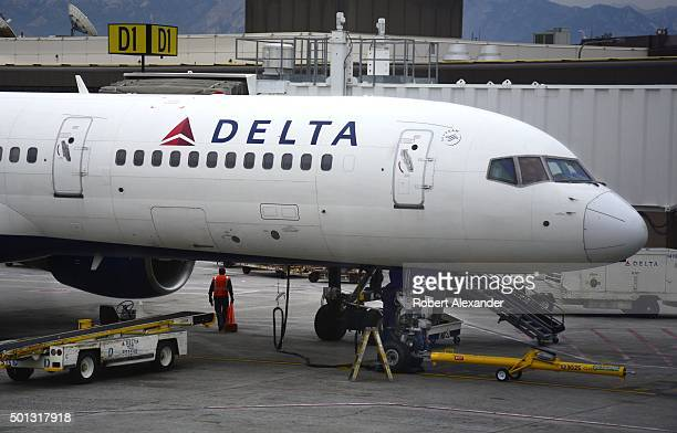 Delta Airlines Airbus A320 passenger aircraft is serviced at the gate at Salt Lake City International Airport in Salt Lake City Utah
