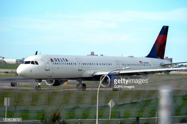 Delta Airlines aircraft taxiing at La Guardia Airport. Delta Air Lines to furlough nearly 2,000 pilots in October, report says.