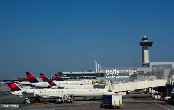 Delta Airlines and Delta Connection passenger jets are serviced at John F Kennedy International Airport in New York New York in the shadow of the...