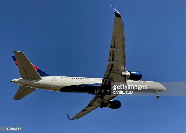 Delta Airlines Boeing 757-251 approaches Washington Ronald Reagan National Airport in Arlington, Virginia on February 24, 2021.