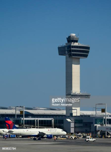 Delta Airlines Boeing 777 passenger jets are serviced at John F Kennedy International Airport in New York New York with the airport's 32 story...