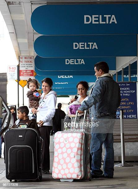 Delta Airlines customers wait to have their baggage checked at San Francisco International Airport January 12 2010 in San Francisco California Delta...