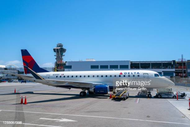 Delta Airlines Embraer ERJ-175 boards from public waiting area while Terminal 3 is under construction at Los Angeles International Airport on May 22,...