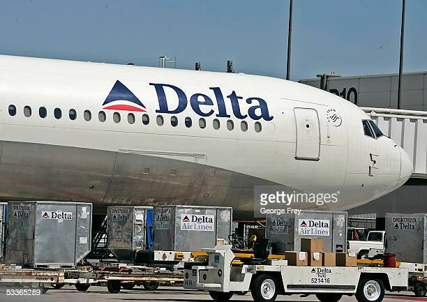 Delta Airlines jet is prepared for flight at the Salt Lake International Airport August 12 2005 in Salt Lake City Utah The resent increase in fuel...