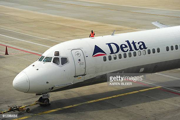 A Delta Airlines jet is pushed back from the terminal before departing HartsfieldJackson Atlanta International Airport in Atlanta Georgeia on...