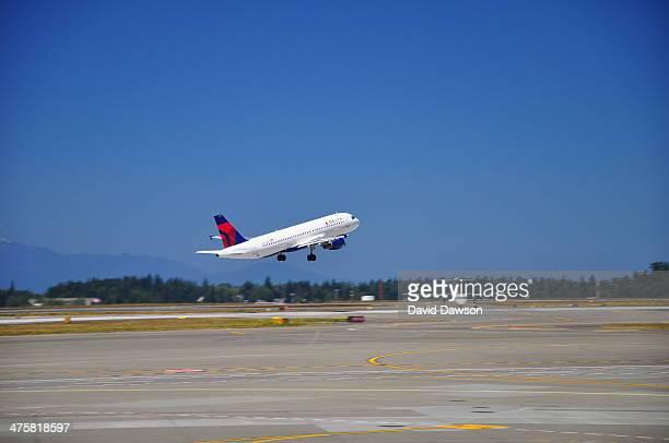 Delta Airlines jet on take off from Sea Tac International airport Seattle, WA US