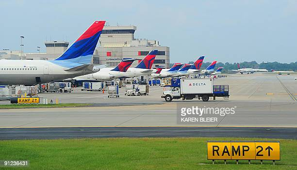 Delta Airlines jets at the terminal at HartsfieldJackson Atlanta International Airport in Atlanta Georgeia on September 12 2009 AFP PHOTO/Karen BLEIER