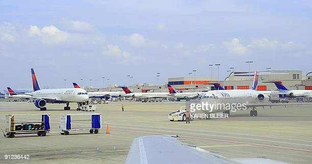 Delta Airlines jets come and go at HartsfieldJackson Atlanta International Airport in Atlanta Georgeia on September 12 2009 AFP PHOTO/Karen BLEIER