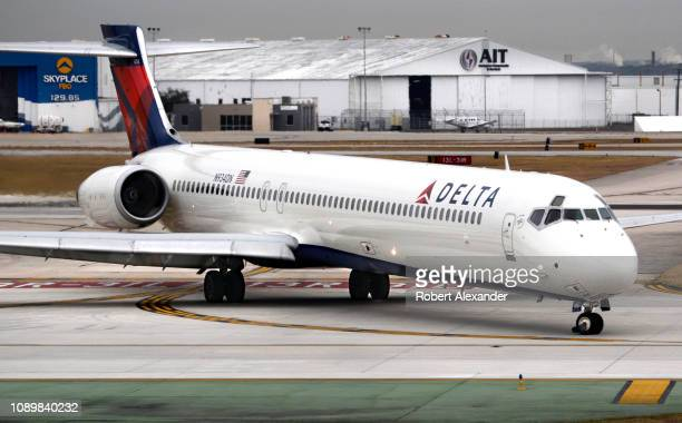 Delta Airlines McDonnell Douglas MD-90 passenger jet taxis after landing at San Antonio International Airport in Texas.