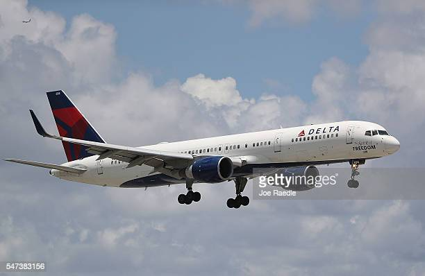 Delta airlines plane is seen as it comes in for a landing at the Fort LauderdaleHollywood International Airport on July 14 2016 in Fort Lauderdale...