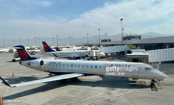 Delta Airlines plane is seen at the gate at Salt Lake City International Airport , Utah, on October 5, 2020.