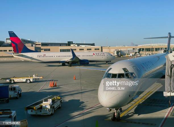 Delta Airlines plane sits on the tarmac at Milwaukee Mitchell International Airportin Milwaukee, Wisconsin on January 8, 2020.