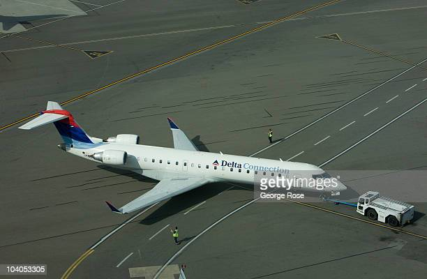 Delta Airlines regional jet aircraft is towed to a Vancouver International Airport gate on July 7, 2010 in Vancouver, British Columbia, Canada....
