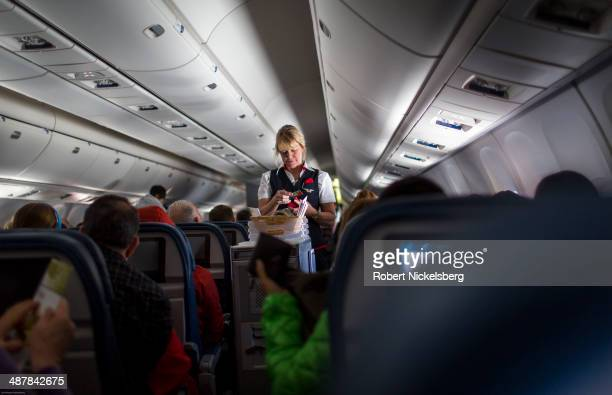 Delta Airlines stewardess sells food on board a San Francisco California bound plane April 11 2014 outside of New York City