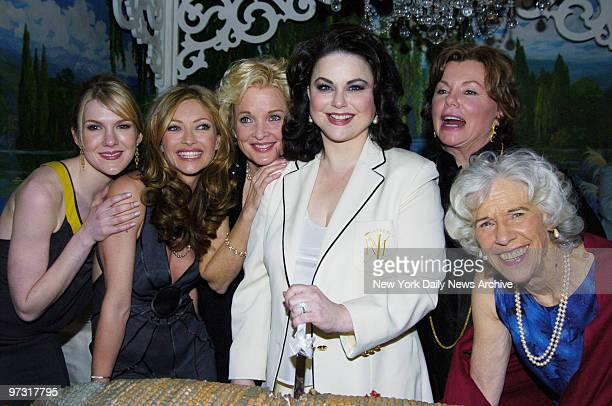 Delta Burke cuts a slice of cake as she's joined by fellow cast members Lily Rabe Rebecca Gayheart Christine Ebersole Marsha Mason and Frances...