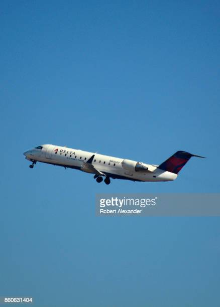 Delta Connection passenger jet takes off from LaGuardia Airport in New York New York