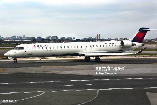 Delta Connection passenger jet taxis at LaGuardia Airport in New York New York