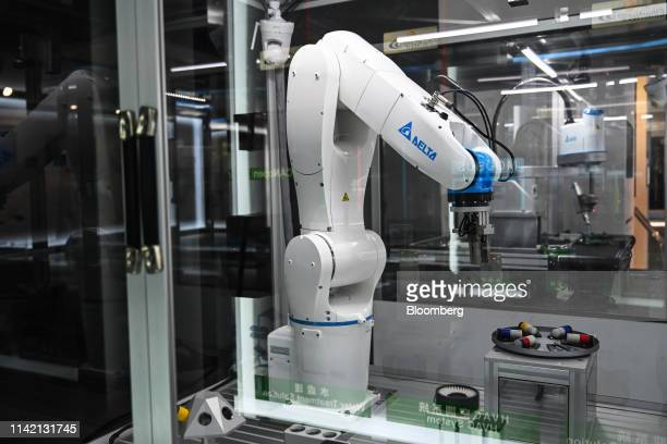 A Delta Electronics Inc articulated robot stands on display in a showroom at the company's headquarters in Taipei Taiwan on Friday May 3 2019 Delta...