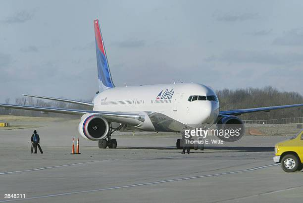 Delta Flight 43 from Paris is shown being directed to a secured location at Cincinnati/Northern Kentucky International Airport amidst security...