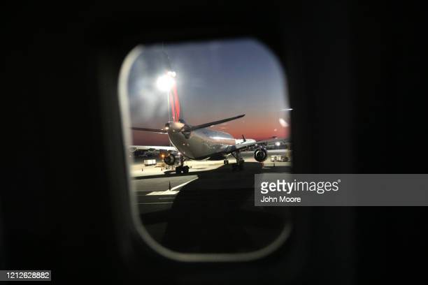 Delta flight arrives nearly empty to JFK Airport on March 15, 2020 near New York City. The state of Washington has over 600 confirmed cases of...