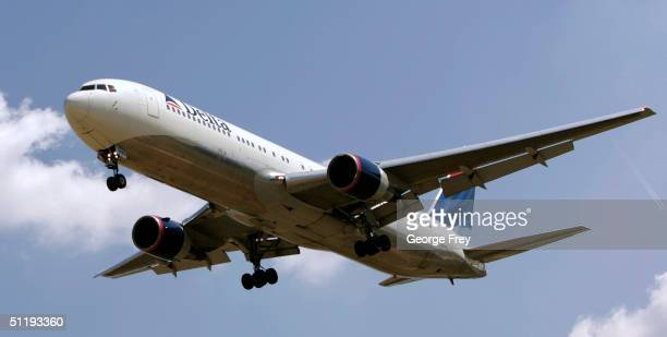 Delta flight lands at the Salt Lake City International Airport August 19 2004 in Salt Lake City Utah Delta is trying to restructure debt to avoid...