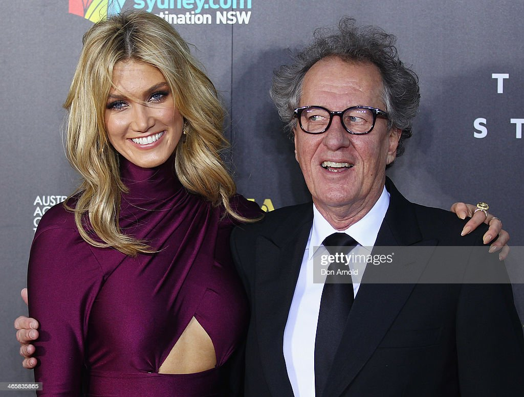 Delta Goodrem and Geoffrey Rush arrive at the 3rd Annual AACTA Awards Ceremony at The Star on January 30, 2014 in Sydney, Australia.
