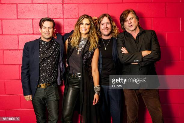 Delta Goodrem and Phil Jamieson Spiderbait's Kram Tex Perkins poses for a portrait backstage at he Footy Show Grand Final edition at Darling Harbour...