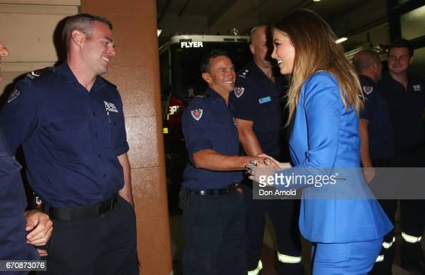 Delta Goodrem greets some onduty firemen at the launch of Delta by Delta Goodrem on April 20 2017 in Sydney Australia