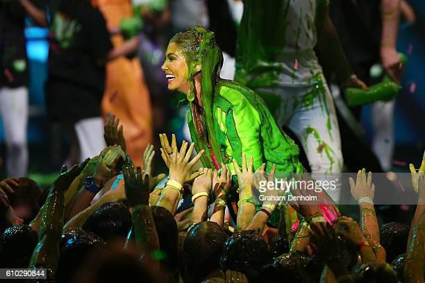 Delta Goodrem is covered in slime during the Nickelodeon Slimefest 2016 evening show at Margaret Court Arena on September 25 2016 in Melbourne...