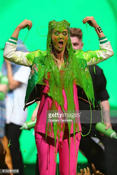 Delta Goodrem is covered in slime during the Nickelodeon Slimefest 2016 evening show at Margaret Court Arena on September 25 2016 in Melbourne...