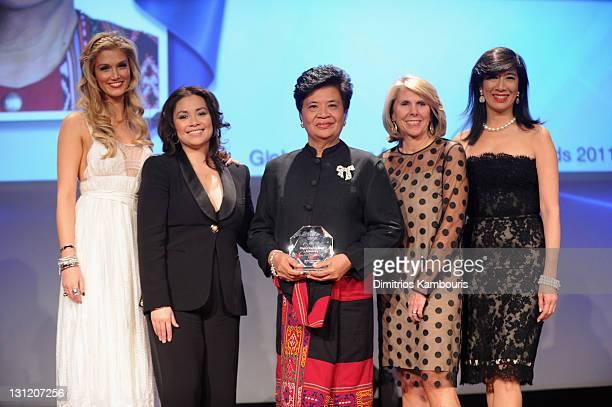 Delta Goodrem, Lea Salonga, Theresa Balayon, executive officer, the Philippines' Women's Crisis Center, Avon Foundation President Carol Kurzig and...