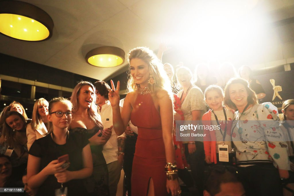 Delta Goodrem poses for photos with fans in the crowd as she arrives at the 59th Annual Logie Awards at Crown Palladium on April 23, 2017 in Melbourne, Australia.