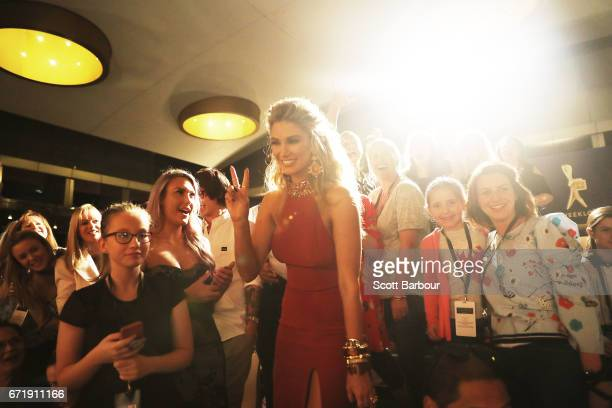 Delta Goodrem poses for photos with fans in the crowd as she arrives at the 59th Annual Logie Awards at Crown Palladium on April 23 2017 in Melbourne...