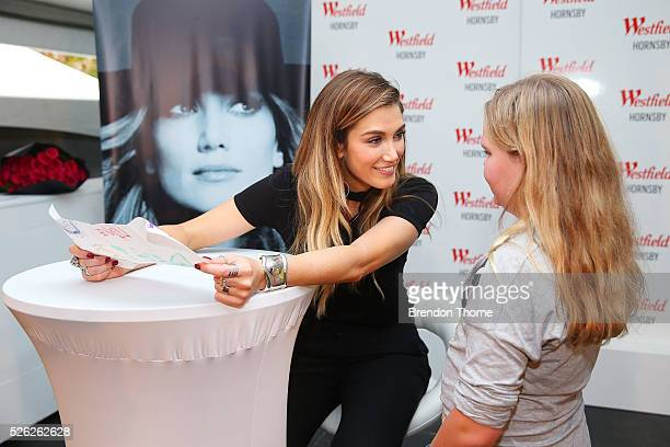 Delta Goodrem signs autographs and poses for photos with fan following the performance of her new single Dear Life at Westfield Hornsby on April 30...
