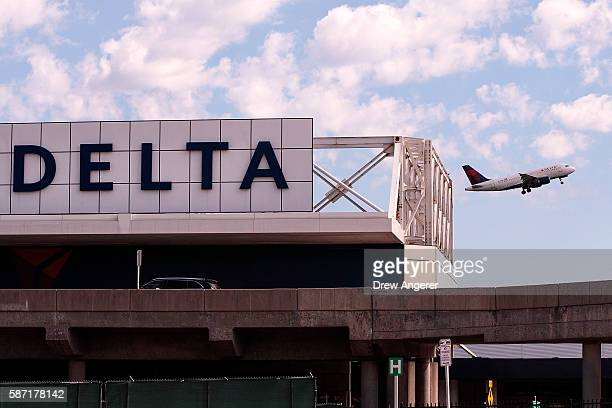Delta jet takes off at LaGuardia Airport , August 8, 2016 in the Queens borough of New York City. Delta flights around the globe were grounded and...